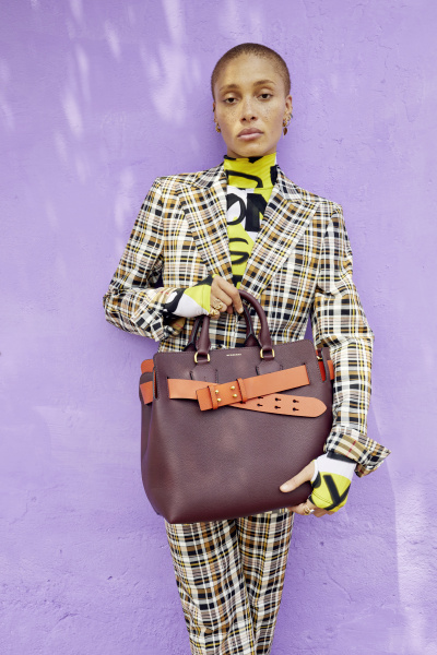 Adwoa Aboah in a graffiti-print bodysuit and tailored check suit and carrying The medium Belt Bag c Courtesy of Burberry_Juergen Teller